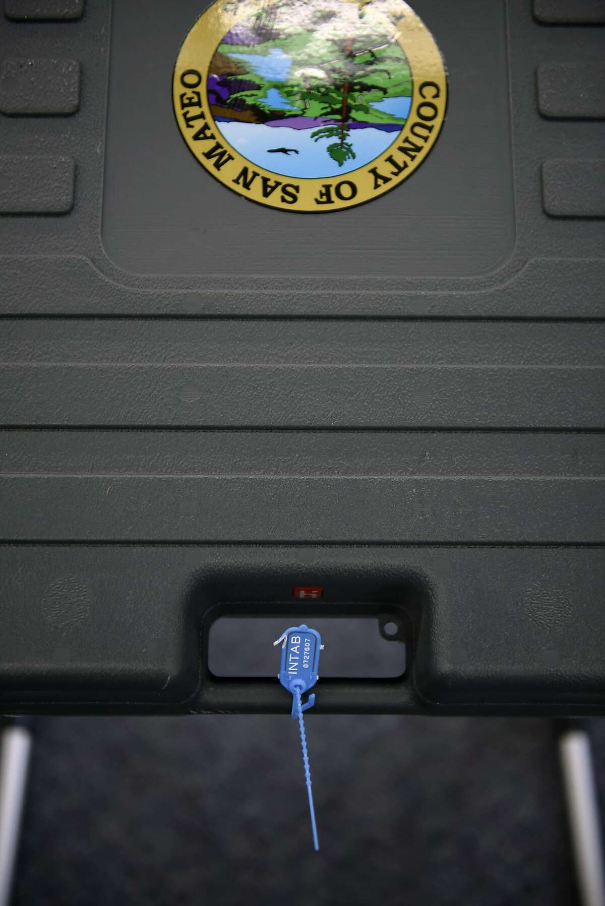 A seal is seen on the handle of a tested Hart Intercivic eSlate voting machines in a room at the San Mateo County Registration & Elections Division building in San Mateo, CA, on Wednesday May 2, 2018.