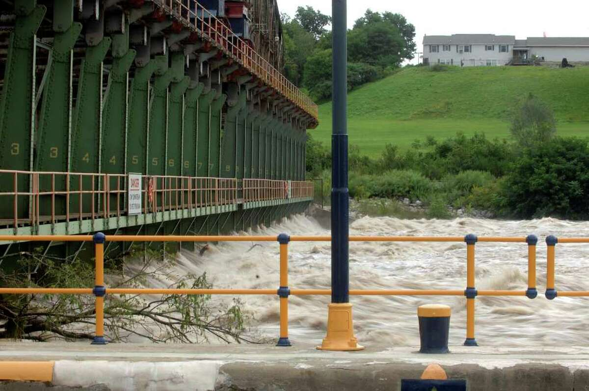 A view of water from the Mohawk River rushing over the dam alongside Lock 15 on the Eire Canal in Fort Plain on Monday, Aug. 23, 2010. Heavy rain on Sunday night caused flooding in the Fort Plain area. (Paul Buckowski / Times Union)