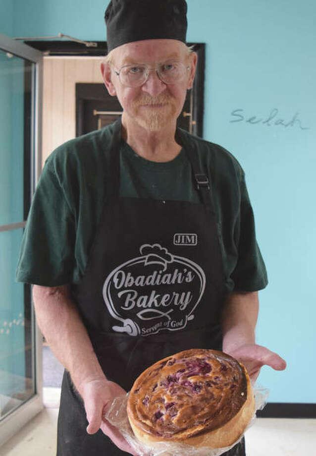 Jim Mullis, owner of Obadiah's Bakery in South Jacksonville, holds a freshly baked blueberry cheesecake. Photo: Rochelle Eiselt | Journal-Courier