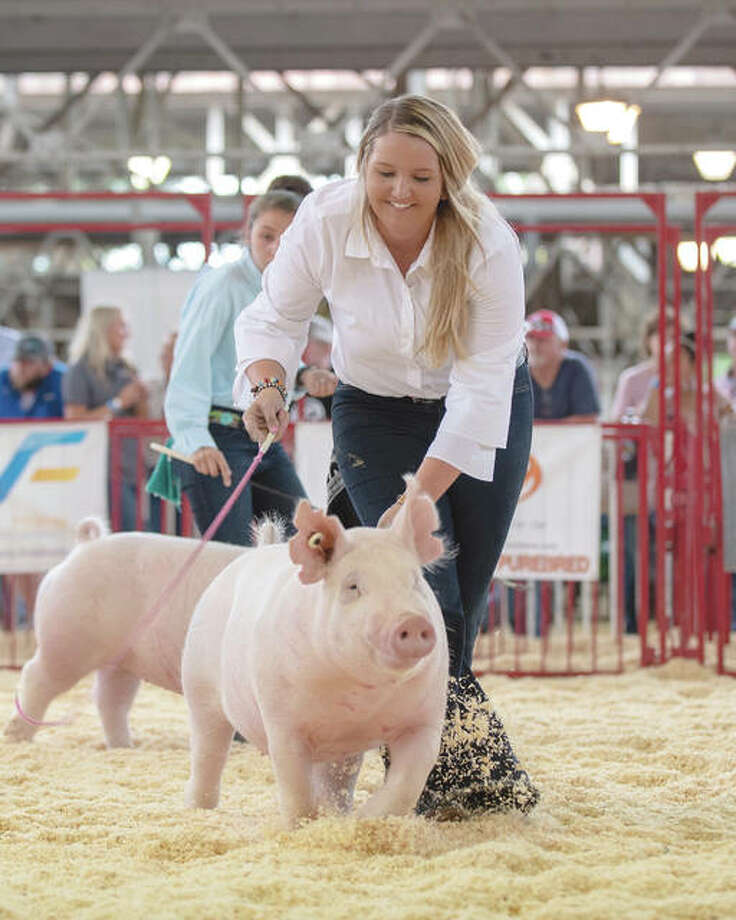 Jenna Wheeler of Jacksonville shows one of her pigs last summer during the World Pork Expo. Photo: Heidi Anderson | Legacy Livestock Imaging