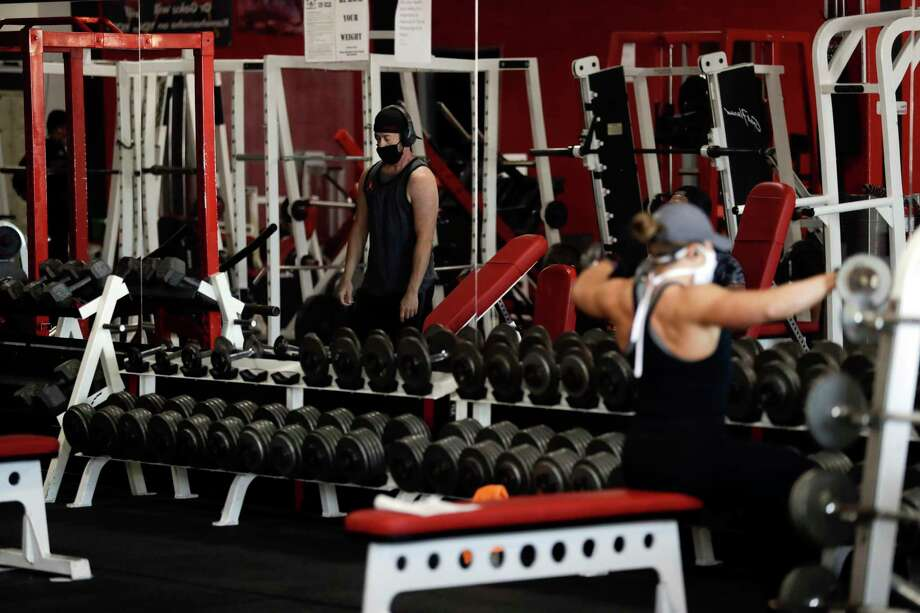 Sports and fitness facilities, including gyms and pools; and indoor recreation such as bowling alleys and movie theaters will also be allowed to reopen June 17. Restrictions on gyms include disabling every other or every third locker to promote social distancing, requiring gym users to wipe down equipment after they use it, and adjusting equipment so athletes are 6 to 12 feet apart from one another. Photo: Gregory Bull / Associated Press / Copyright 2020 The Associated Press. All rights reserved