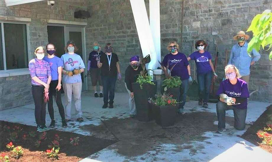 Women of Michigan Action Network (WOMAN) volunteers recently planted flowers at the new Shelterhouse facility on Waldo Road in Midland. (Photo provided)