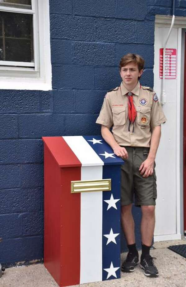 Ian Holly with Flag Deposit Box he created for VFW. Photo: Sabina Harris / Contributed Photo