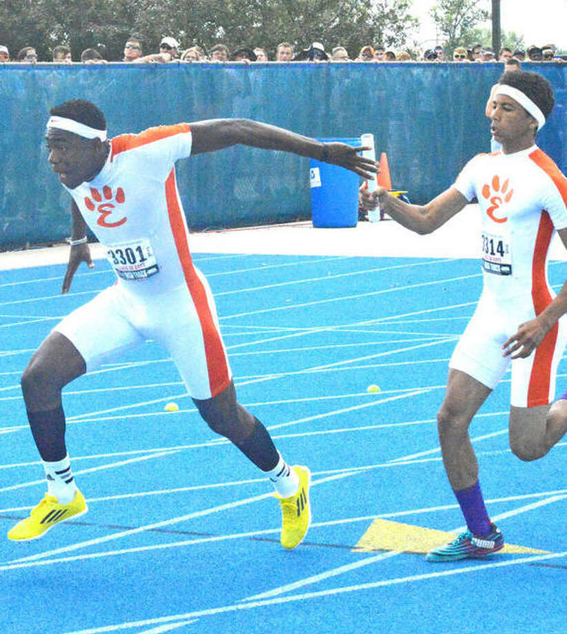 Edwardsville's Fontez Davis, left, takes a handoff from Devonte Tincher in the 400-meter relay at the 2015 Class 3A state meet. Davis ran on three medal-winning relays and was first in the long jump. Photo: Intelligencer File Photo