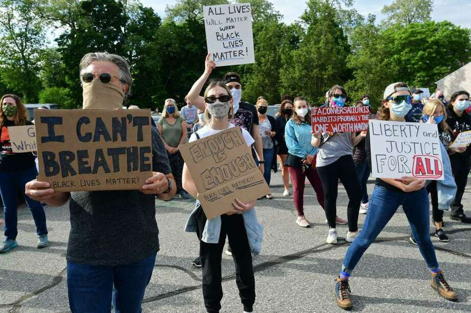 A crowd of near two hundred gathered along route 7 at Our Lady of Fatima Catholic Church in Wilton on June 2, 2020, to protest police brutality. Photo: Erik Trautmann / Hearst Connecticut Media