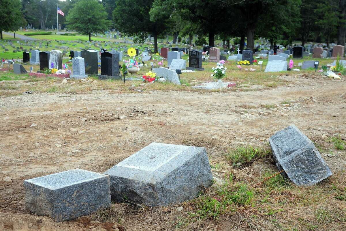 Headstones that have been toppled and moved in Park Cemetery, in Bridgeport, Conn. Oct. 2, 2018.
