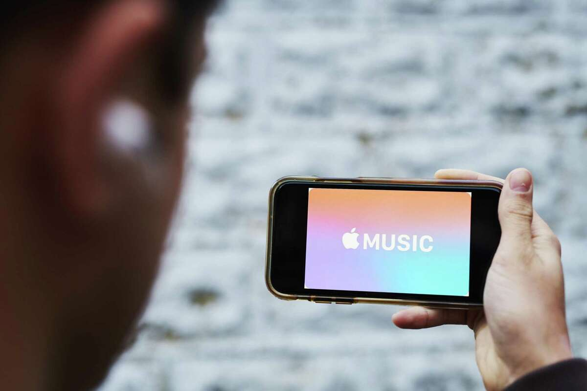 Apple Music streaming service signage is displayed on an iPhone.