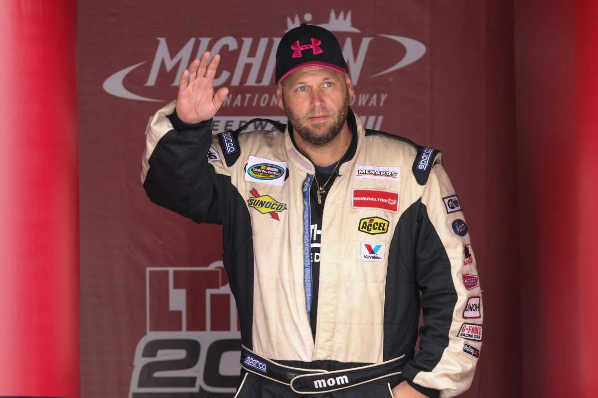 BROOKLYN, MI - AUGUST 12: Ray Ciccarelli (0), driver of the Driven2Honor.org Chevrolet, greets fans during the pre-race ceremonies of the Camping World Truck Series LTi Printing 200 race on August 12, 2017 at Michigan International Speedway in Brooklyn, Michigan. (Photo by Scott W. Grau/Icon Sportswire via Getty Images)