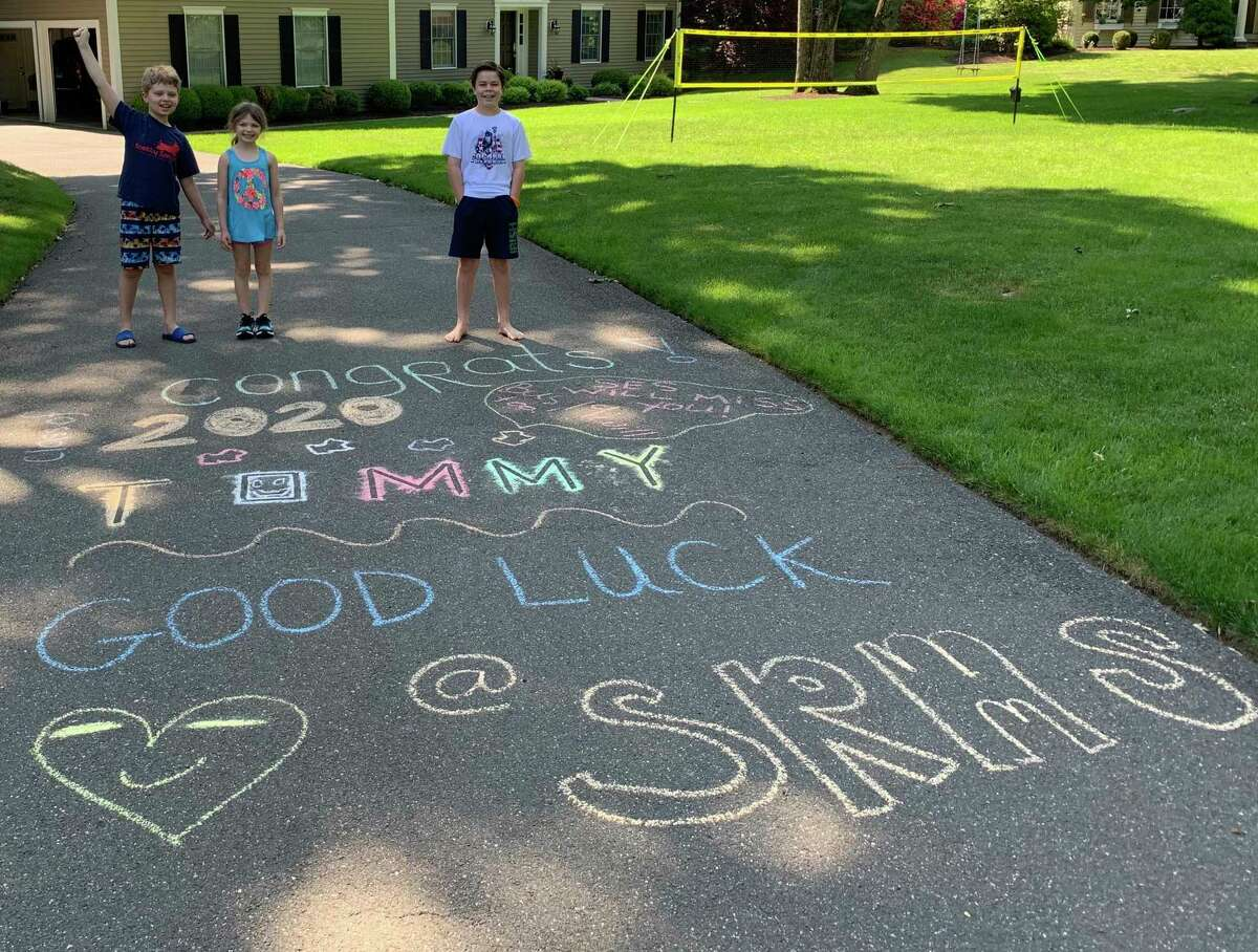 Scotland Elementary students Aiden and Abigail A. decorated 5th grader Tommy L's driveway wishing him well as he moves up to middle school.