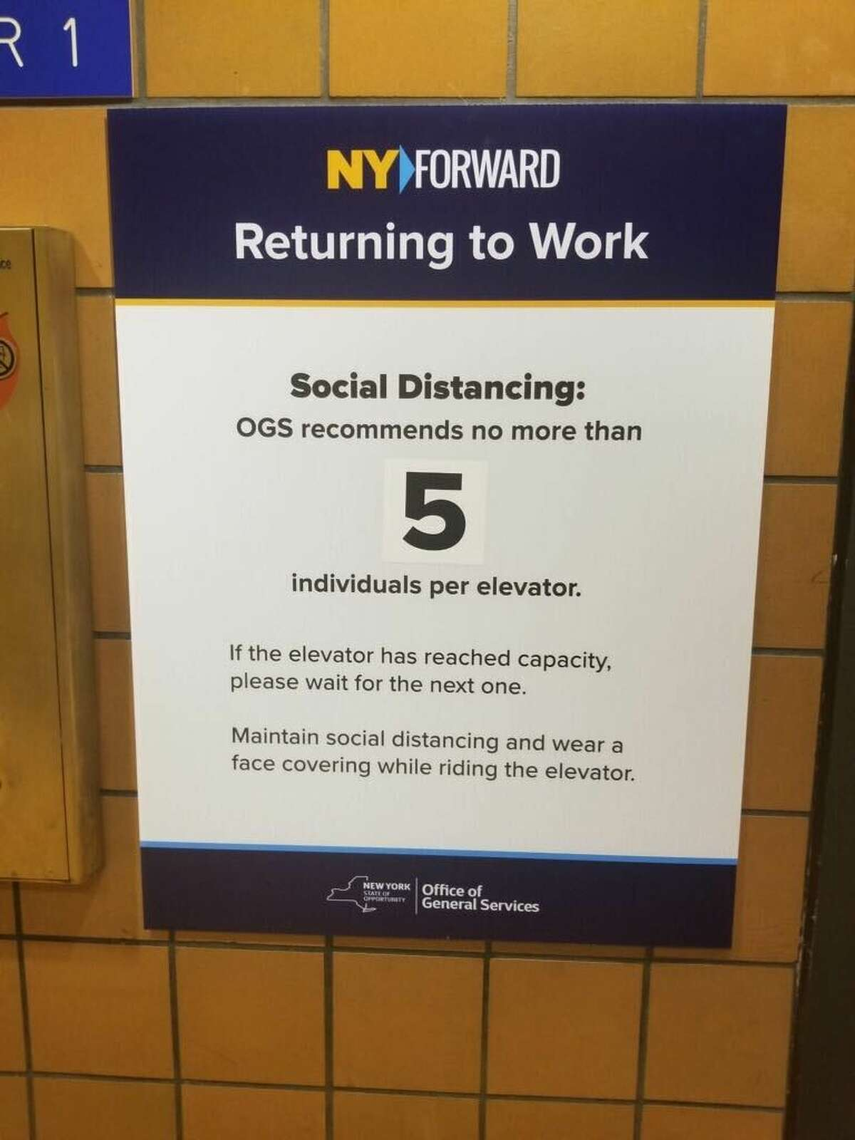 A sign is posted in the Swan Street building in Albany as state employees return to the office. (Submitted photo)