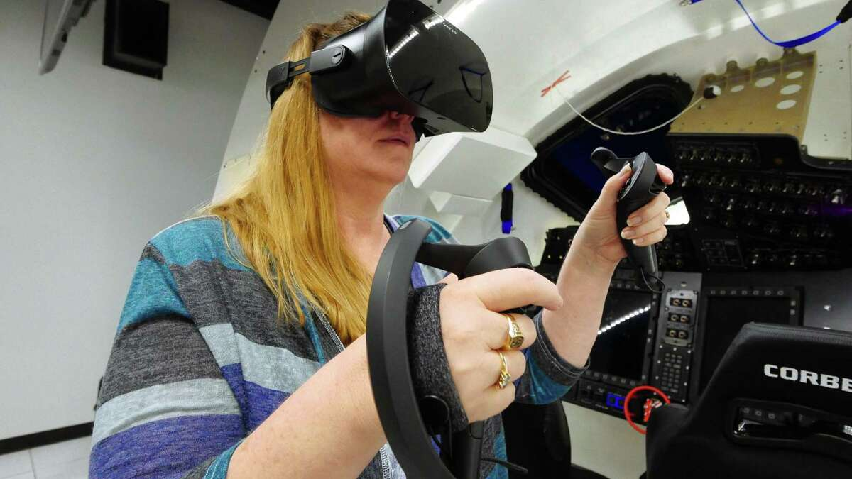 Connie Miller, a software engineer in Boeing's IT department who supports the company's space program, uses a Varjo virtual reality headset that astronauts will start using to augment simulator training for Boeing's CST-100 Starliner spacecraft.
