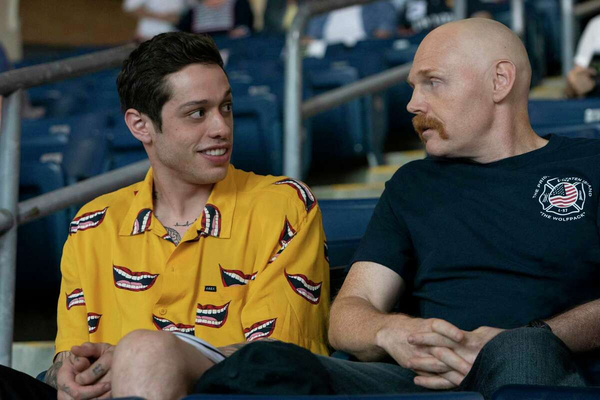 """In this image released by Universal Pictures, Pete Davidson, left, and Bill Burr appear in a scene from """"The King of Staten Island,"""" directed by Judd Apatow."""