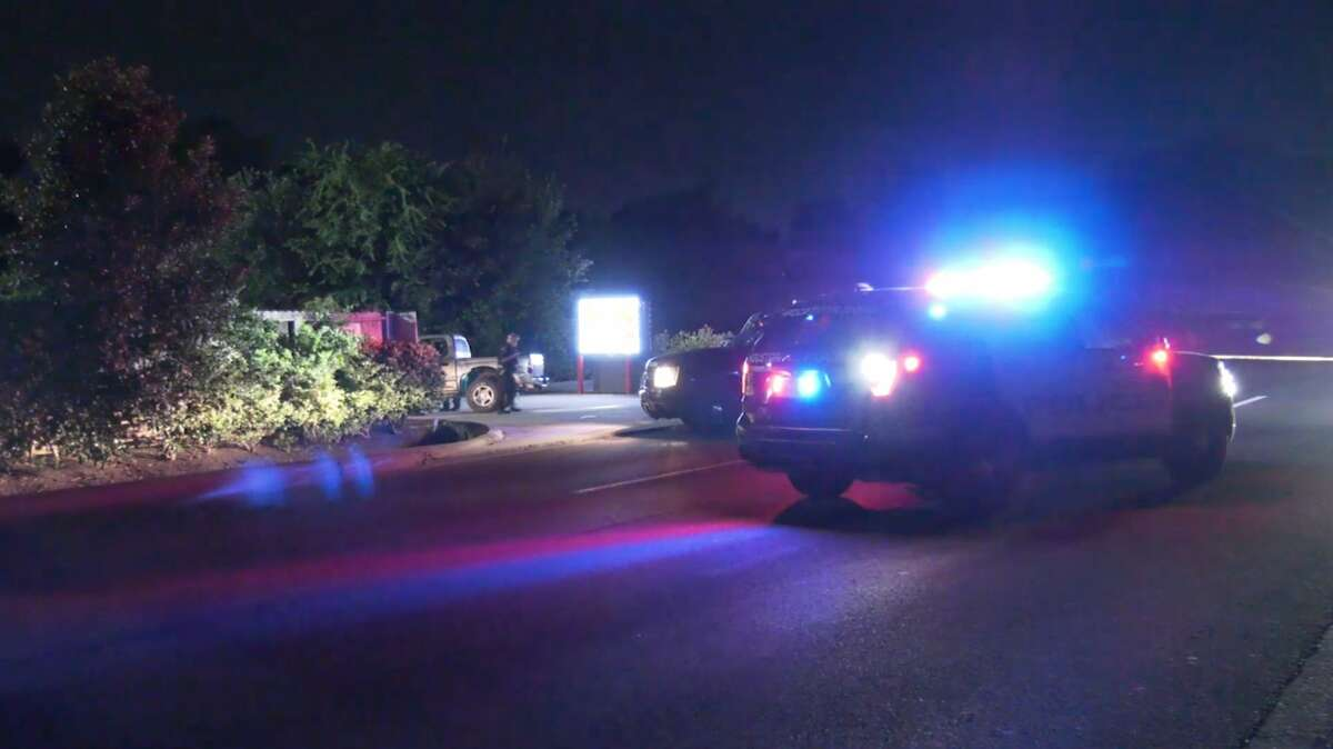 Houston police investigate a deadly shooting at a southwest motel Wednesday, June 10, 2020.