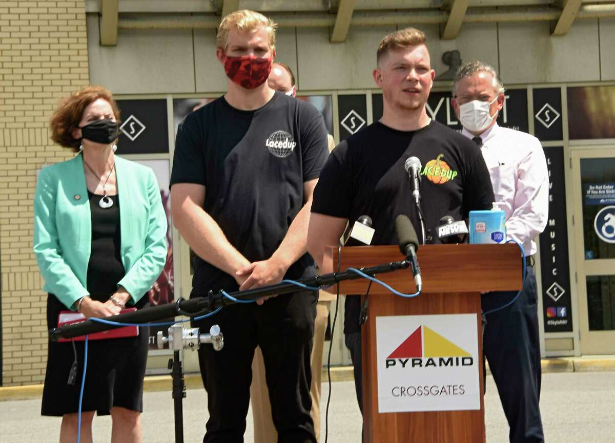Entrepreneurs Phil Pevzner, at microphone, and his brother Andrew, owners of Laced Up, urge that indoor malls and small businesses, who are otherwise eligible to begin reopening in a safe and responsible manner, are considered in upcoming Phase 3 as part of the state?•s reopening plan, NY-FORWARD during a press conference at Crossgates Mall on Thursday June 11, 2020 in Guilderland, N.Y. The businesses owners were joined by leaders from the local business community. (Lori Van Buren/Times Union)