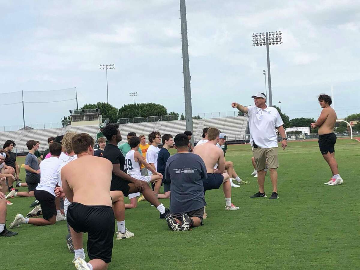Stratford High School football coach and Campus Athletic Director Todd Rankin addresses the football team after its sport-specific training session following a session of strength and conditioning camp on June 10