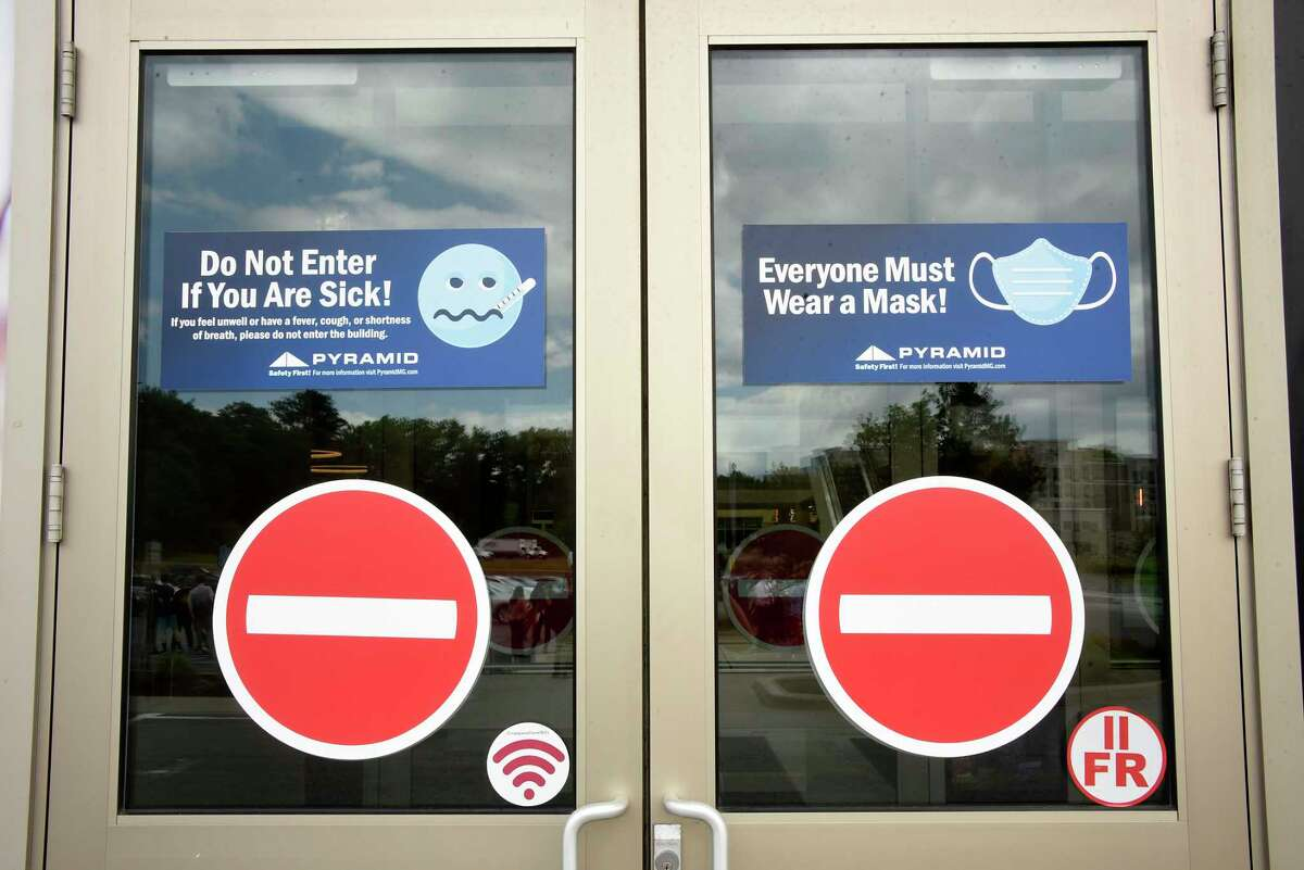 Safety signs are seen on the doors at Crossgates Mall on Thursday June 11, 2020 in Guilderland, N.Y. Assemblymember Patricia Fahy held a press conference urging that indoor malls and small businesses, who are otherwise eligible to begin reopening in a safe and responsible manner, are considered in upcoming Phase 3 as part of the state?•s reopening plan, NY-FORWARD. Fahy was joined by leaders from the local business community. (Lori Van Buren/Times Union)