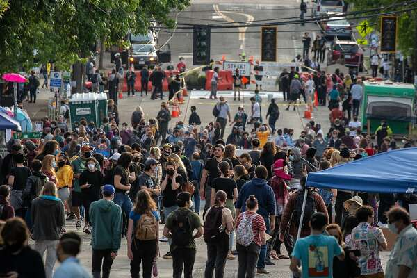 """SEATTLE, WA - JUNE 10: People walk near the Seattle Police Departments East Precinct in the so-called """"Capitol Hill Autonomous Zone"""" on June 10, 2020 in Seattle, Washington. The zone includes the blocks surrounding the Seattle Police Departments East Precinct, which was the site of violent clashes with Black Lives Matter protesters, who have continued to demonstrate in the wake of George Floyds death. (Photo by David Ryder/Getty Images)"""
