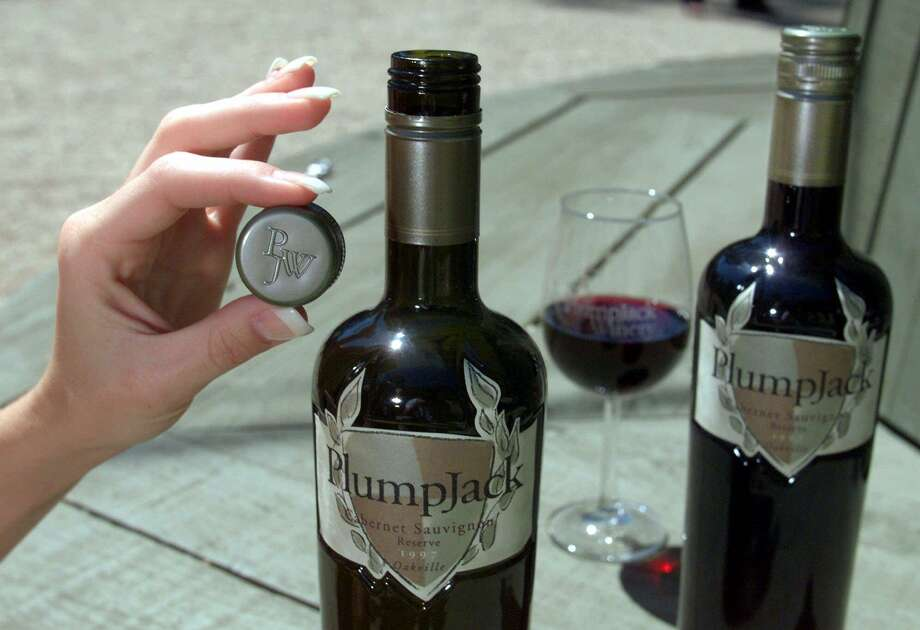 A screw-top cap is displayed next to a premium bottle of 1997 PlumpJack Reserve Cabernet Sauvignon wine at the PlumpJack Winery in Oakville, Calif. Ron Saikowski said he goes for white wines with a screw cap. Winemakers use the screw cap to keep their lighter wines crisp, fresh, and fruit-forward. Those screw caps are a good way to assist you in selecting those light wines. Once selected, chill those wines down. Photo: ERIC RISBERG, Staff / Associated Press / AP