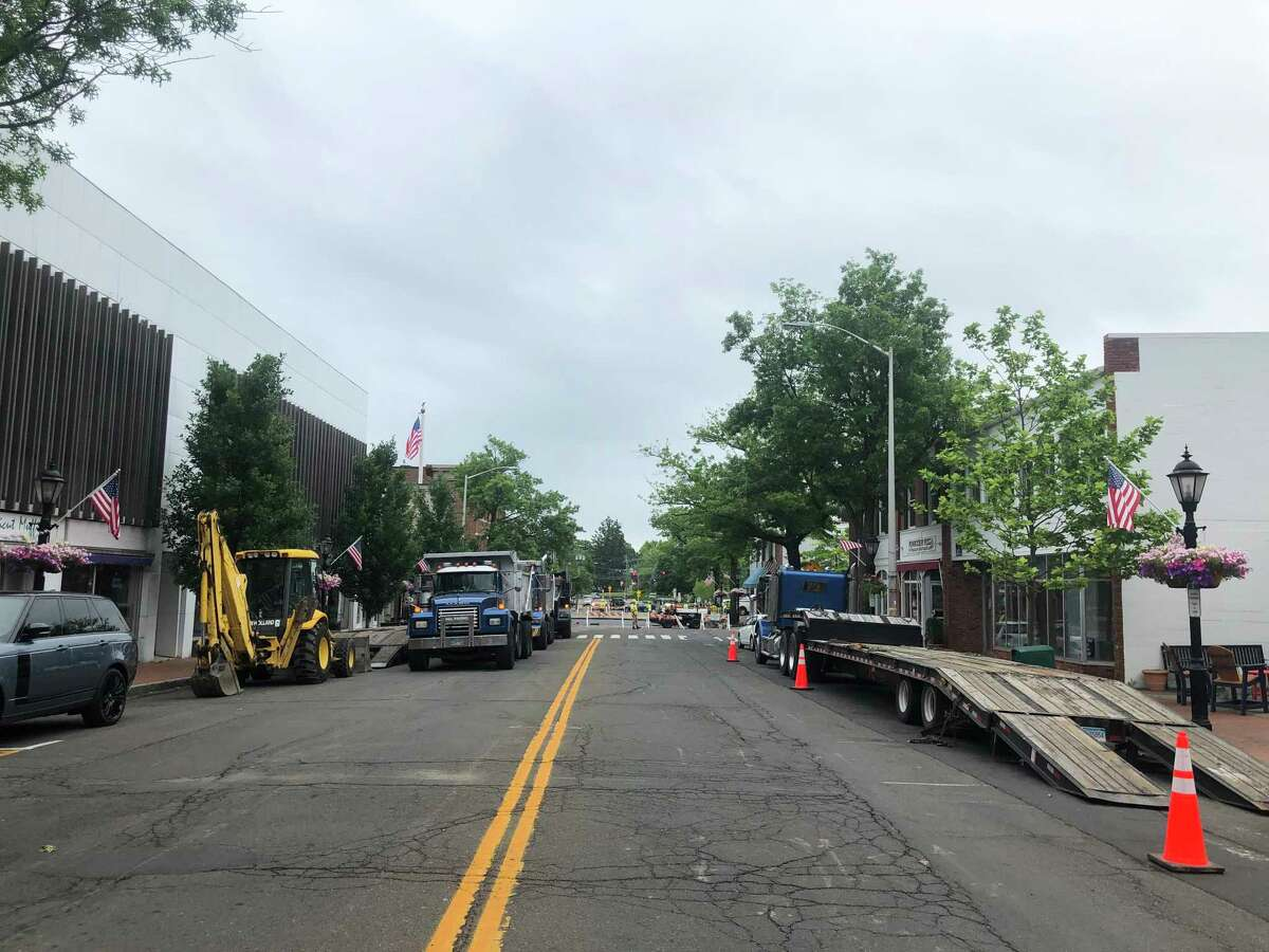 New Canaan Department of Public Works employees put the finishing touches on fixing a water main break on Main Street between Cherry Street, and Burtis Avenue in New Canaan, on Thursday, June 11, 2020.