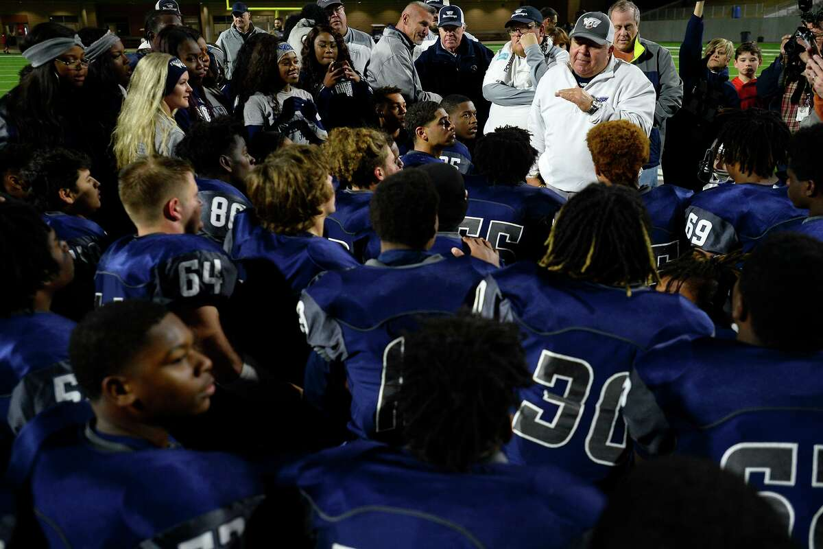 West Orange-Stark coach Cornel Thompson talks with the players after they beat Wimberley in the Class 4A Division 2 state semifinal game at Legacy Stadium in Katy on Friday night. Photo taken Friday 12/15/17 Ryan Pelham/The Enterprise