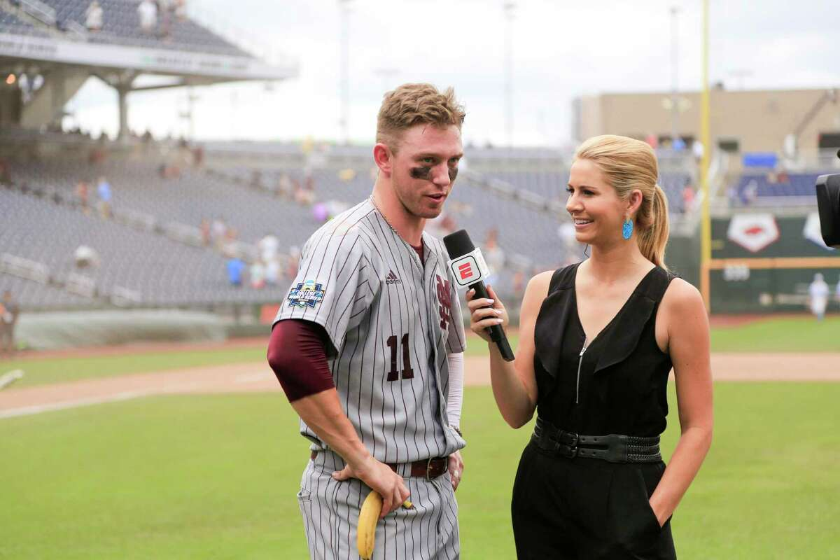 ESPN's Laura Rutledge interviews Mississippi State designated hitter Jordan Westburg (11), who drove in seven runs in an NCAA College World Series baseball game against North Carolina, in Omaha, Neb., Tuesday, June 19, 2018. Mississippi State won 12-2. (AP Photo/Nati Harnik)