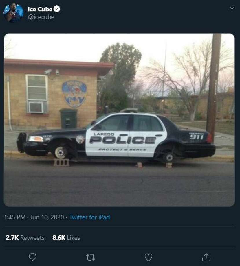 Locals reacted to Ice Cube's tweet on Wednesday featuring one of Laredo's most iconic viral photos in Laredo history. The photo shows a Laredo Police Department car on cinder blocks after its tires were stolen in 2014. Photo: Twitter.com