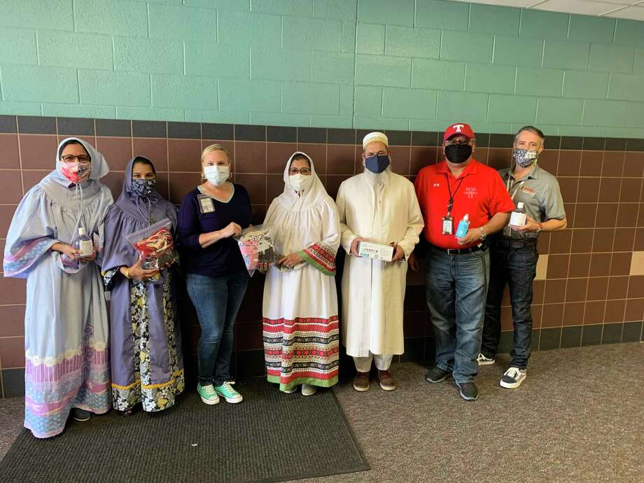 Members of a local Muslim community called the Dawoodi Bohra recently donated personal protective equipment to officials with the Tomball Independent School District, in an effort to help protect workers in the community meal distribution program. Photo: Courtesy Images / Courtesy Images