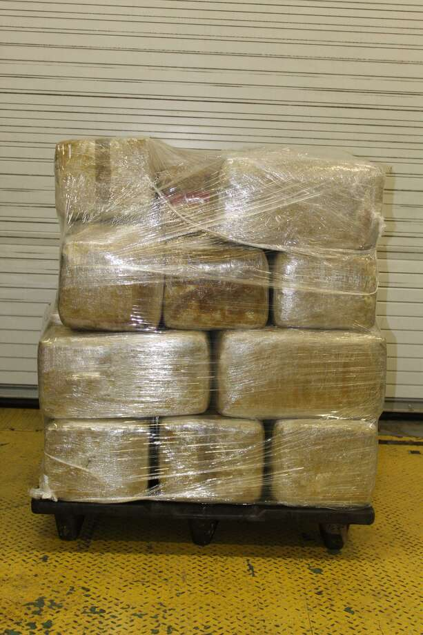 U.S. Customs and Border Protection officer said they seized these bundles of marijuana on Monday at the World Trade Bridge. The contraband weighed more than 570 pounds and had an estimated street value of about $115,000. Photo: Courtesy Photo /U.S. Customs And Border Protection
