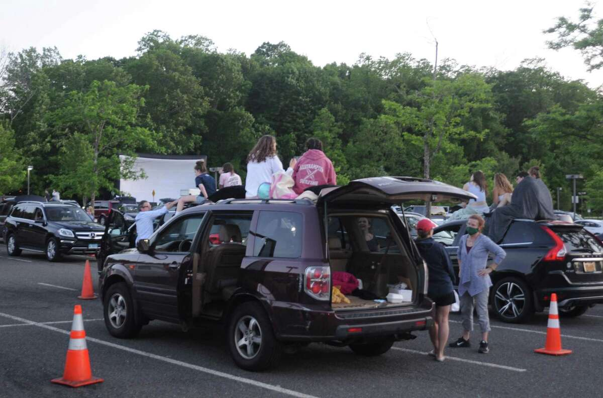 Saturday night's movies in the parking lot at Ridgefield High School drew about 150 cars and 500 viewers.