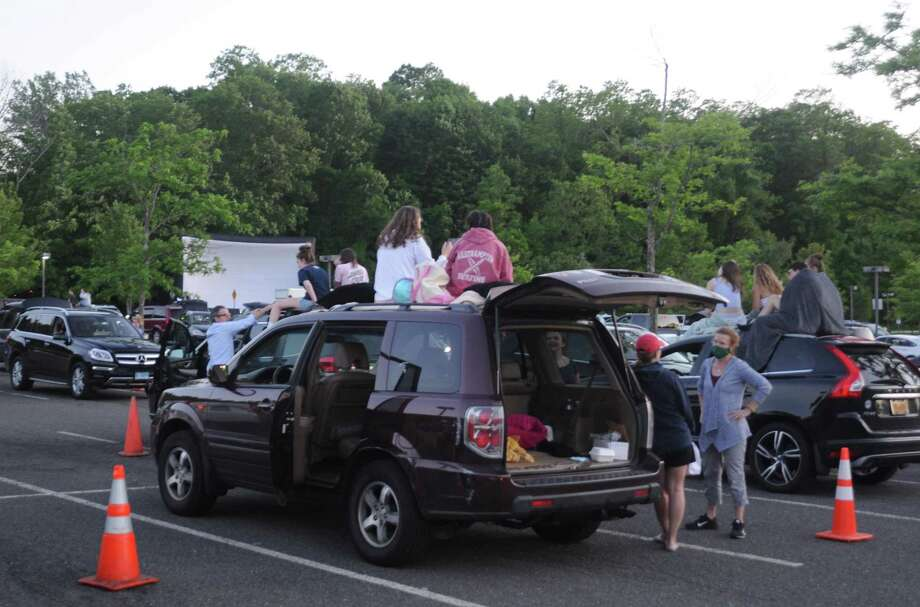 Saturday night's movies in the parking lot at Ridgefield High School drew about 150 cars and 500 viewers. Photo: Macklin Reid /