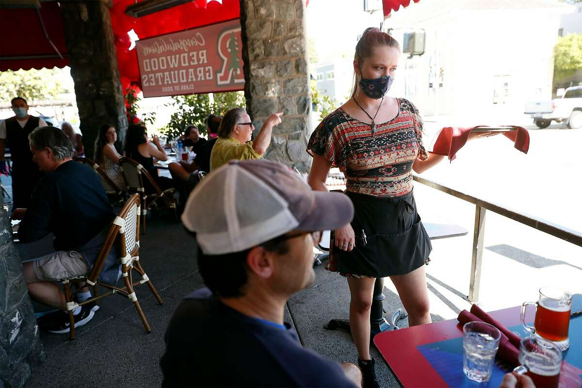 Stephanie Light takes an order at Left Bank Brasserie in Larkspur, Calif., on Wednesday, June 10, 2020. The French restaurant is open for outdoor dining only.