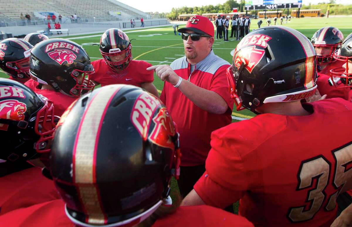 Caney Creek head coach Ned Barrier talks with players before a non-district high school football game at Woodforest Bank Stadium, Thursday, Sept. 5, 2019, in Shenandoah.