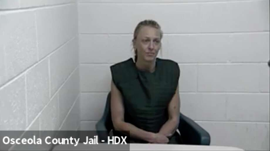 Nicole Veranda Wagner, 37, of Marion is pictured sitting in the Osceola County Jail as she awaits arraignment Thursday, via Zoom, in Osceola County District Court. Wagner is charged with one count of open murder after she allegedly shot and killed a 29-year-old woman. Photo: Photo Courtesy Of Zoom