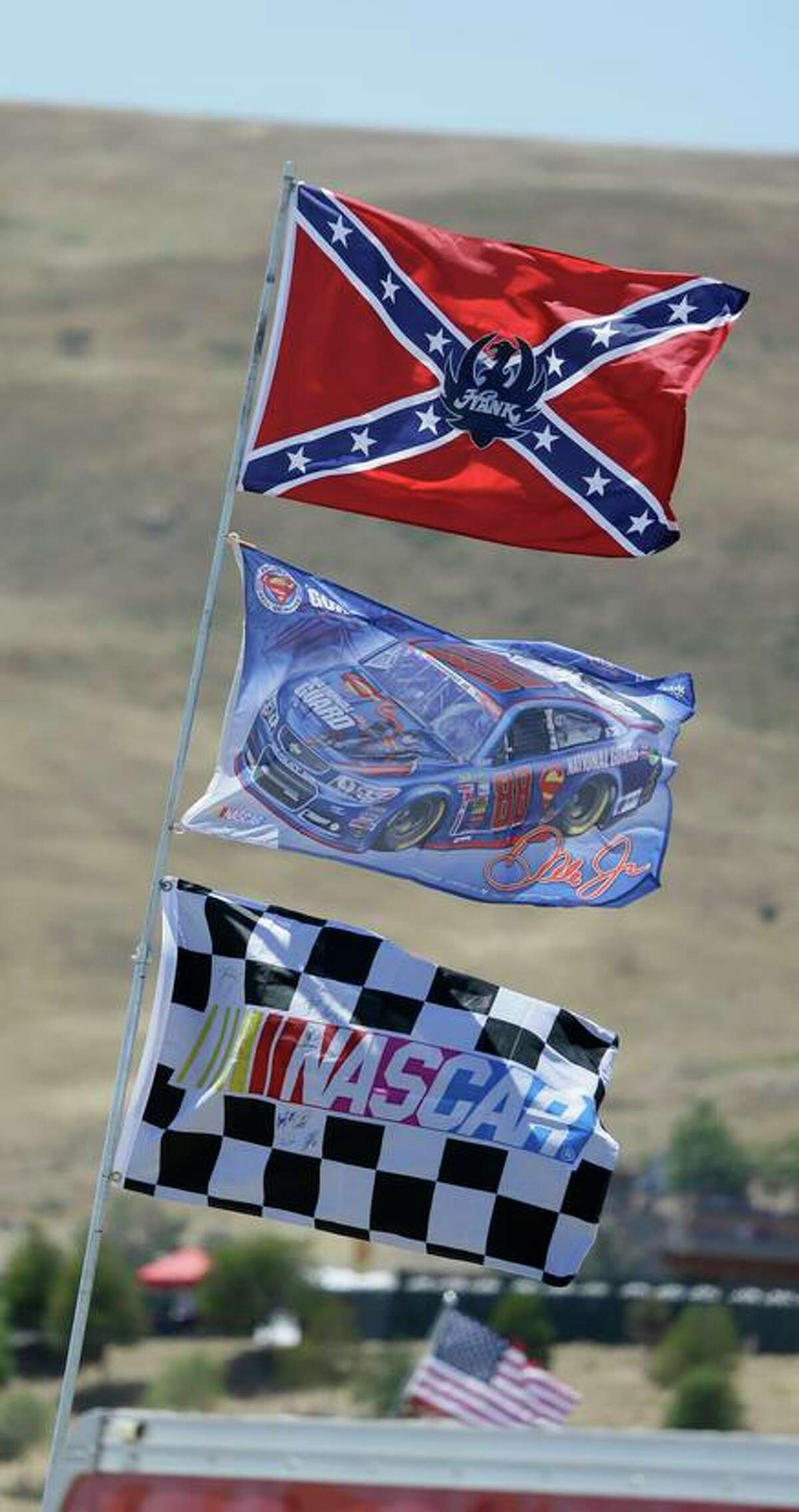 NASCAR said on Wednesday that Confederate flags - like this one flying at Sonoma Raceway - are now banned from the racing circuit.