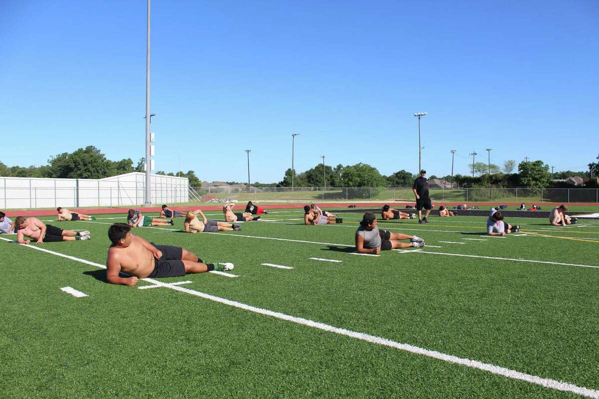 Kingwood Park begins its final day of summer strength and conditioning of the week at Panthers Stadium.