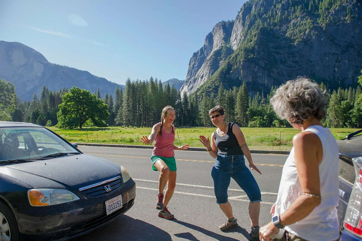 Mary Scudder, (left) of Olancha, Calif., Suzanna Betts, of Nevada City, and Kathy Rodrigue, of Penn Valley, dance before departing Yosemite National Park on Thursday, June 11, 2020. The trio was on a multi-day backpacking trip in the park.