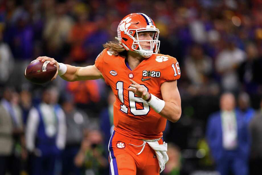 NEW ORLEANS, LA - JANUARY 13: Trevor Lawrence #16 of the Clemson Tigers passes against the LSU Tigers during the College Football Playoff National Championship held at the Mercedes-Benz Superdome on January 13, 2020 in New Orleans, Louisiana. (Photo by Jamie Schwaberow/Getty Images) Photo: Jamie Schwaberow / Getty Images / 2020 Jamie Schwaberow 2020 Jamie Schwaberow