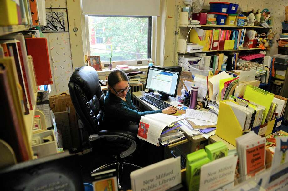 Meghan Morin, Young Adult Librarian, works at her desk in the New Milford Public Library, Tuesday, October 25, 2016, in New Milford, Conn. Photo: H John Voorhees III / Hearst Connecticut Media / The News-Times