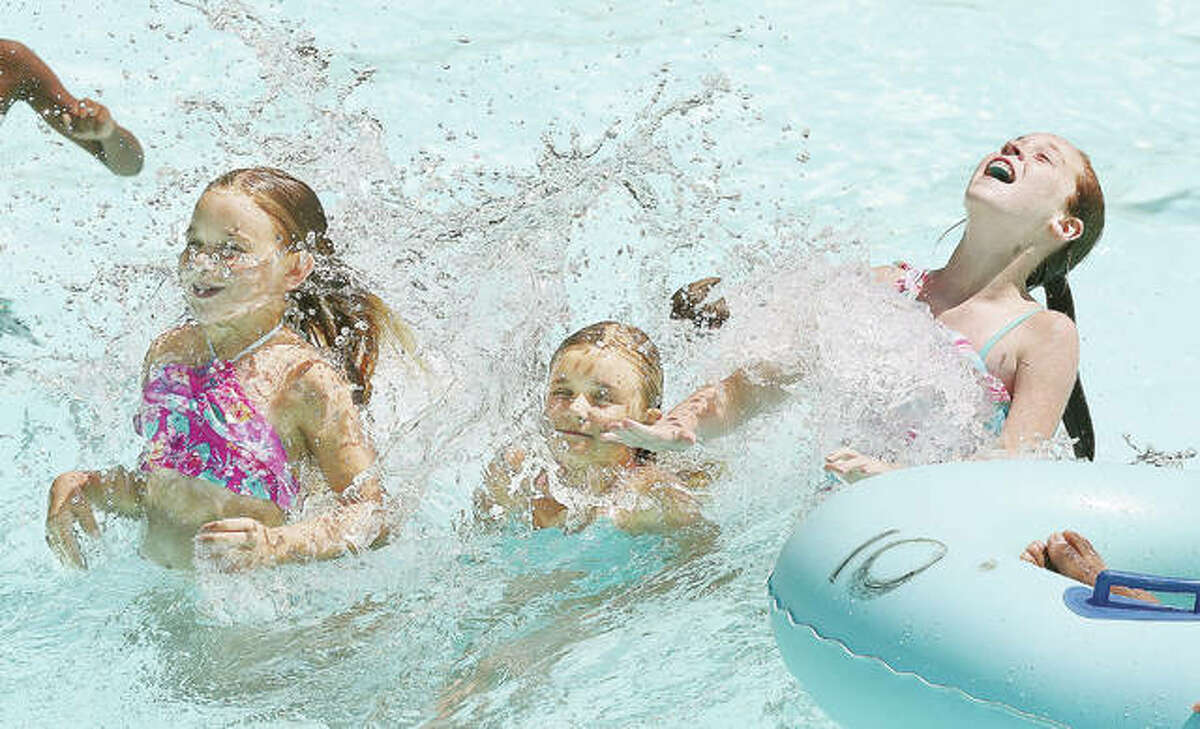 In this July 2019 file photo, three girls enjoy the wave pool at the Raging Rivers Waterpark in Grafton. On Thursday the park announced it plans to open for the 2020 season on June 26.