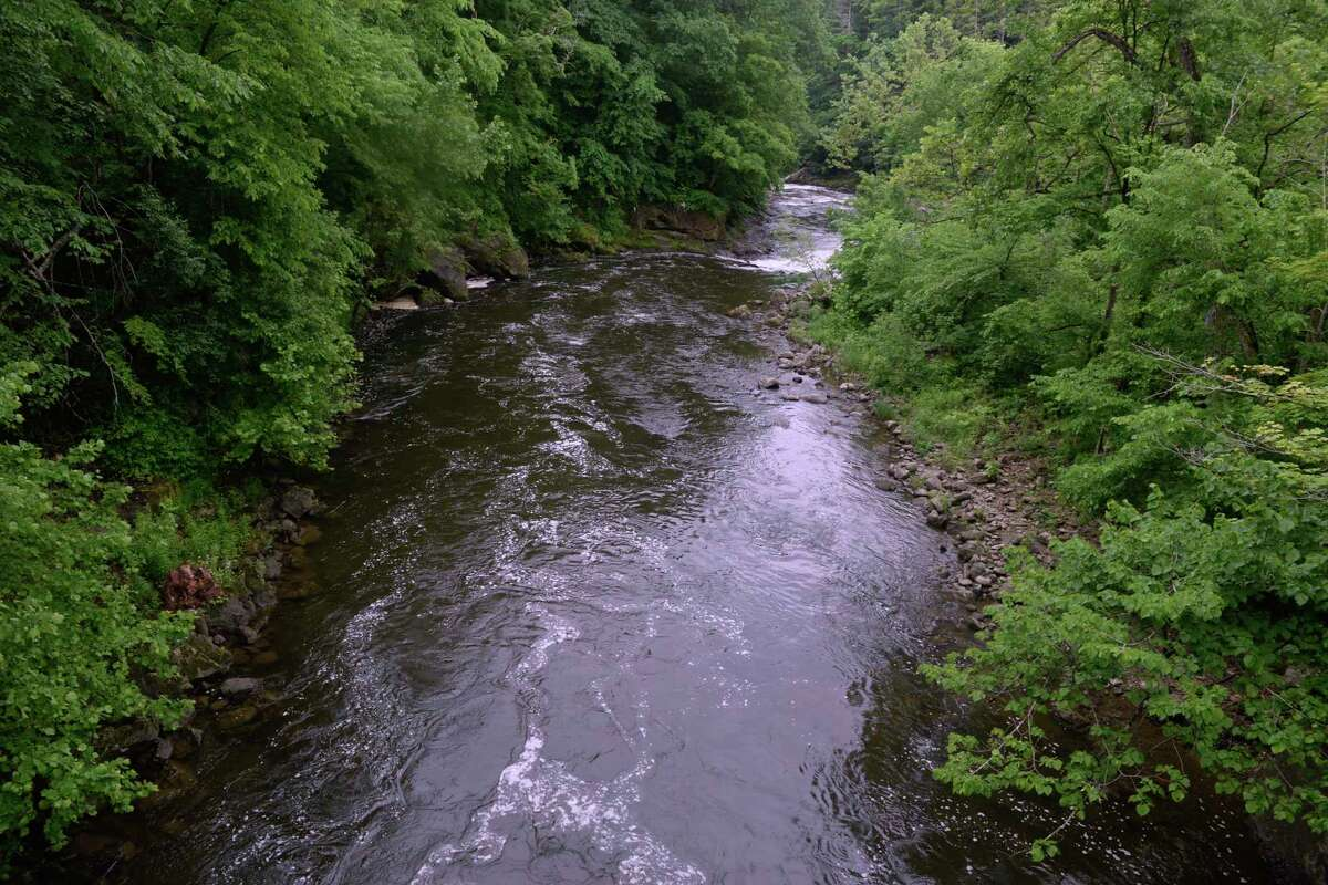 The Housatonic River running through the First Light Bulls Bridge Recreation Area near where two New York men went missing Wednesday while swimming in the river. June 11, 2020, in Kent, Conn.
