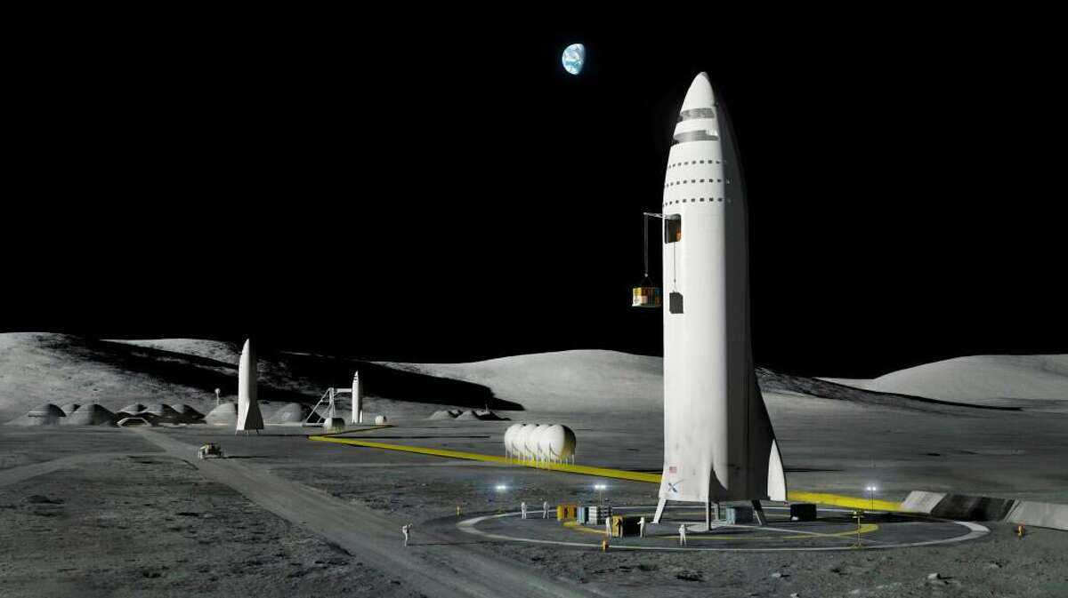 This artist's rendering made available by Elon Musk on Friday, Sept. 29, 2017 shows SpaceX's mega-rocket design on the Earth's moon. Amazon's Jeff Bezos and Virgin Galactic's Richard Branson favor going back to the moon before Mars. Musk also is rooting for the moon, although his heart's on Mars.