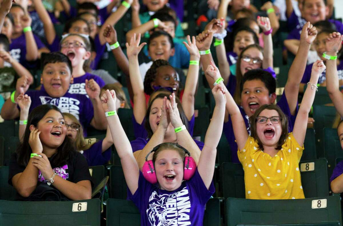 Willis students cheer as monster truck enter the arena as 4,500 elementary students from Conroe and Willis ISD attended the Arabia Shriners Monster Truck Spectacular at the Montgomery County Fairgrounds, Friday, Sept. 13, 2019, in Conroe.
