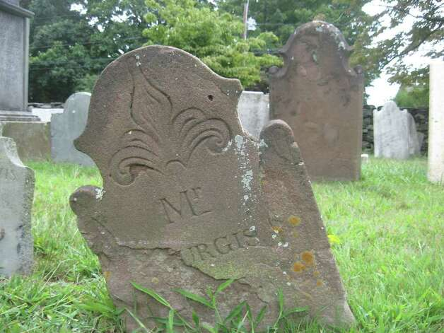 Unfortunately, some of the headstones, like this one, are missing chunks and are beyond full restoration. Photo: Tim Loh / Fairfield Citizen