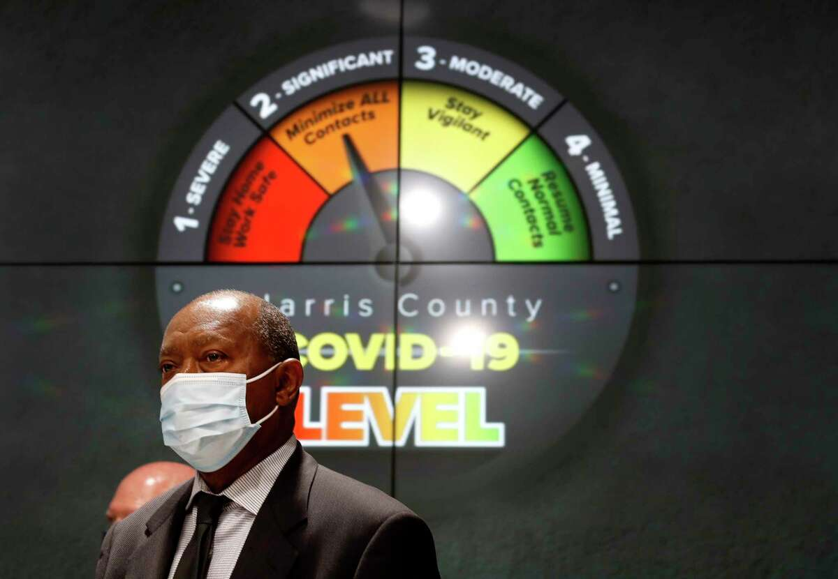 Houston Mayor Sylvester Turner listens to Harris County Judge Lina Hidalgo speak at a press conference to announce that Harris County had reached level two-orange due to the increase in the number of coronavirus cases accounted for in the last days at Transtar, Thursday, June 11, 2020.