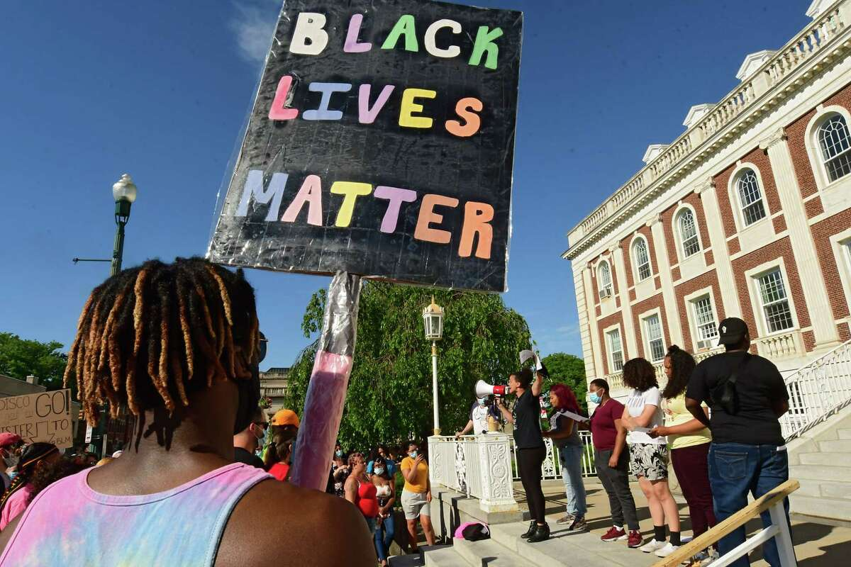Jamaica Miles, co-founder of All of Us Community Action Group, speaks as people rally in front of Schenectady City Hall calling on Mayor Gary McCarthy to make changes in the Schenectady Police Department on Thursday June 11, 2020 in Schenectady, N.Y. (Lori Van Buren/Times Union)