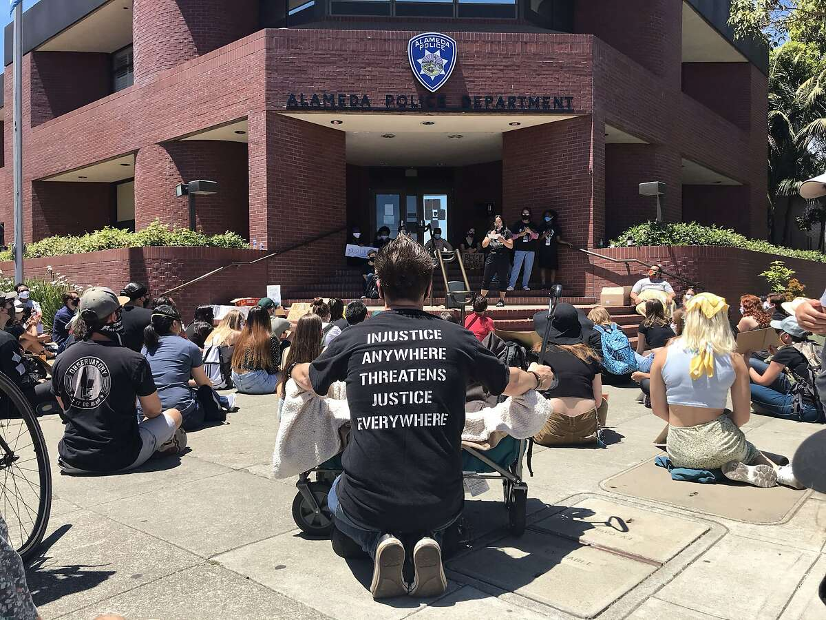 Demonstrators conduct a sit-in in front of the Alameda Police station in Alameda, Calif. on Thursday, June 11, 2020.