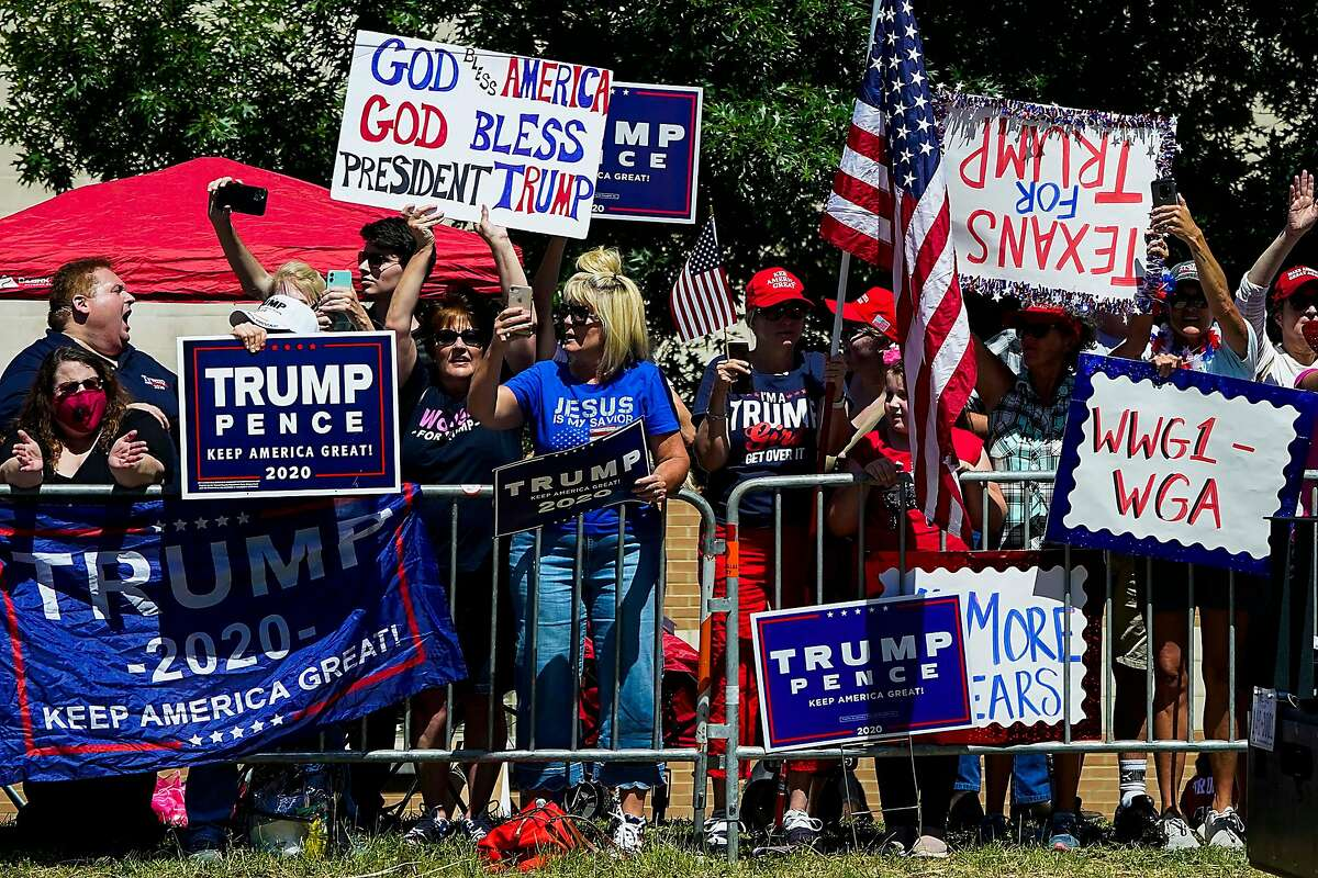 Supporters gather on the road near the church as President Donald Trump�s motorcade moves from Dallas Love Field Airport en route to Gateway Church Dallas Campus for a roundtable conversation about race relations and policing on Thursday, June 11, 2020, in Dallas. (Smiley N. Pool/The Dallas Morning News)