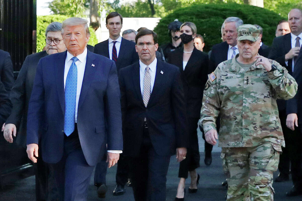 FILE - In this June 1, 2020 file photo, President Donald Trump departs the White House to visit outside St. John's Church, in Washington. Part of the church was set on fire during protests on Sunday night. Walking behind Trump from left are, Attorney General William Barr, Secretary of Defense Mark Esper and Gen. Mark Milley, chairman of the Joint Chiefs of Staff. Milley says his presence a€œcreated a perception of the military involved in domestic politics.a€ He called it a€œa mistakea€ that he has learned from. (AP Photo/Patrick Semansky)