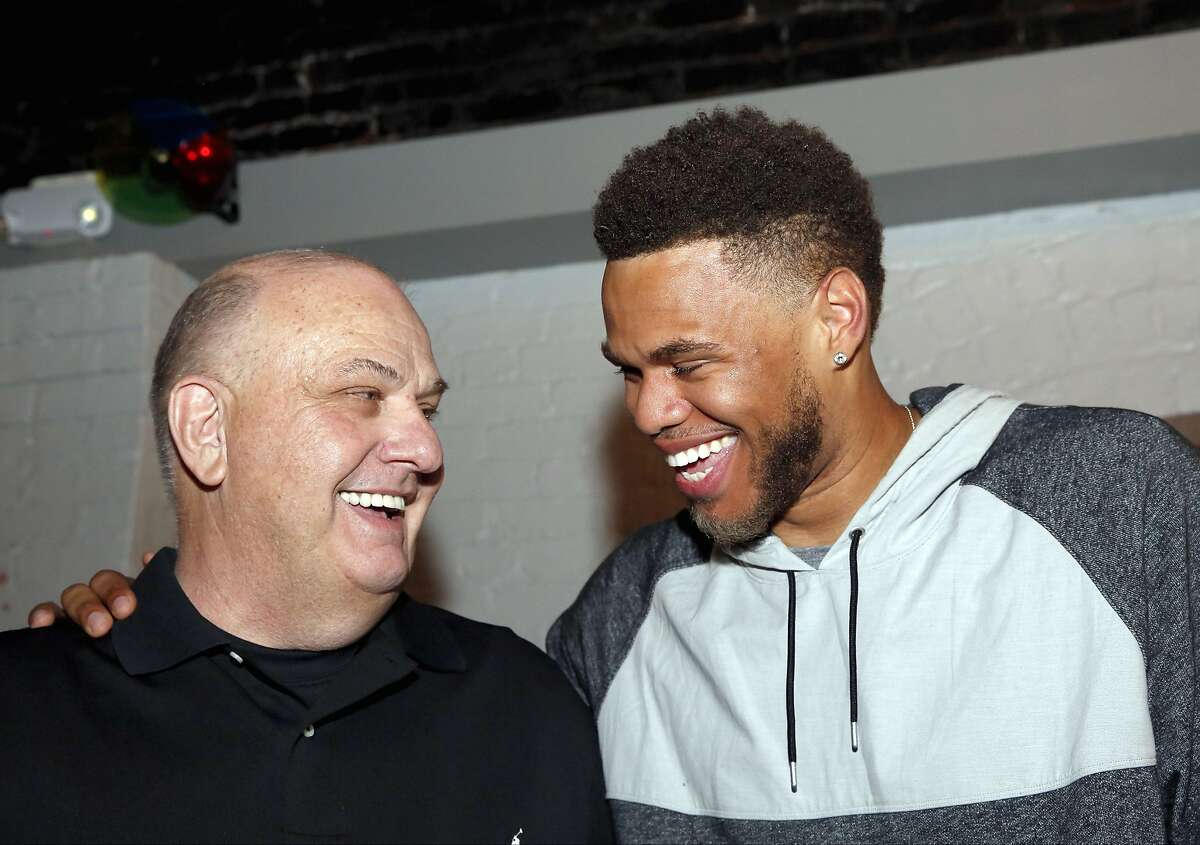 In this photo taken Thursday night, June 25, 2015, Justin Anderson, right, celebrates with his high school basketball coach Stu Vetter during a NBA basketball draft party in Fredricksburg, Va., after learning that he was selected by Dallas Mavericks with the 21st pick overall. (Sarah Ann Jump/The Free Lance-Star via AP)