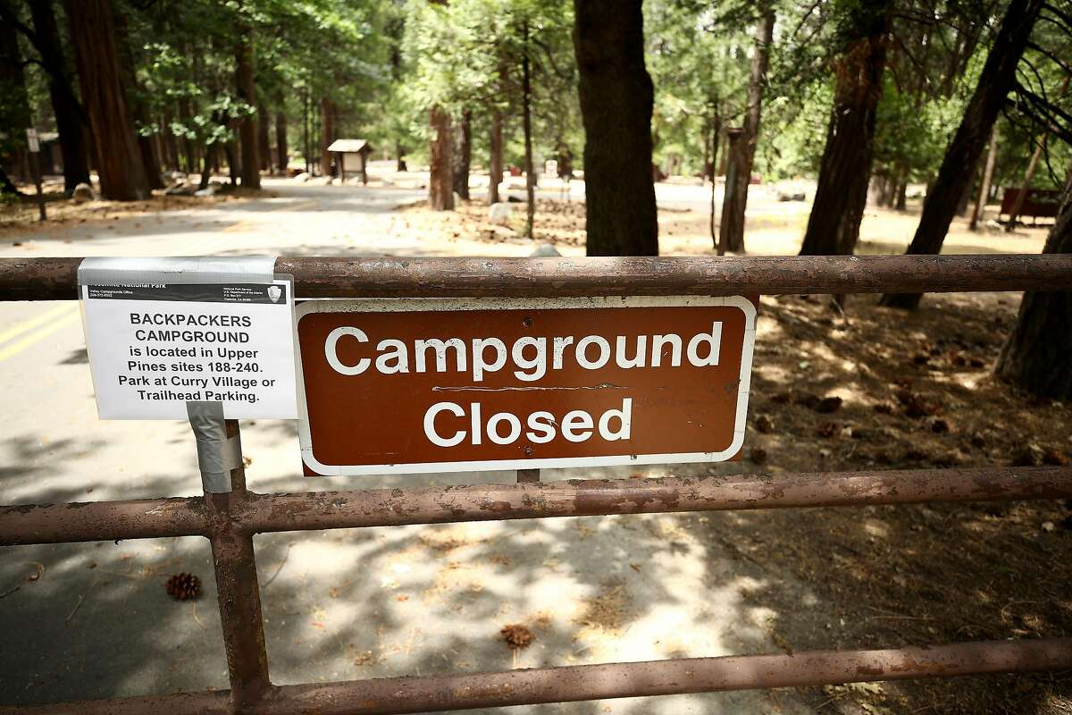 A view of a closed campground sign on June 11, 2020 in Yosemite National Park, California. (Photo by Ezra Shaw/Getty Images)
